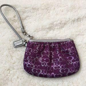 Little wristlet Coach bag.